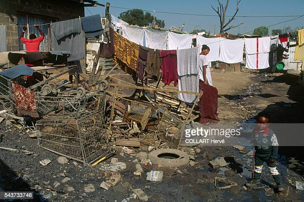 A young mother calls to her son in the slums of the Johannesburg township of Alexandra Situated paradoxically close to the wealthy suburb of Sandton...