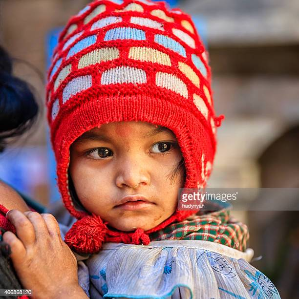 Young mother carrying her baby, Kathmandu, Nepal