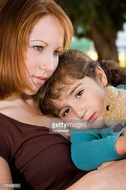 Young Mother Comforting daughter - series