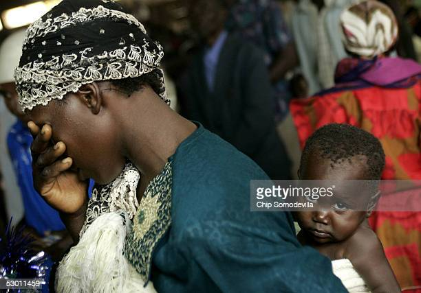 A young mother covers her eyes while praying at the Catholic Basilica Church of the Uganda Martyrs a day before the Ugandan national Martyrs Day...
