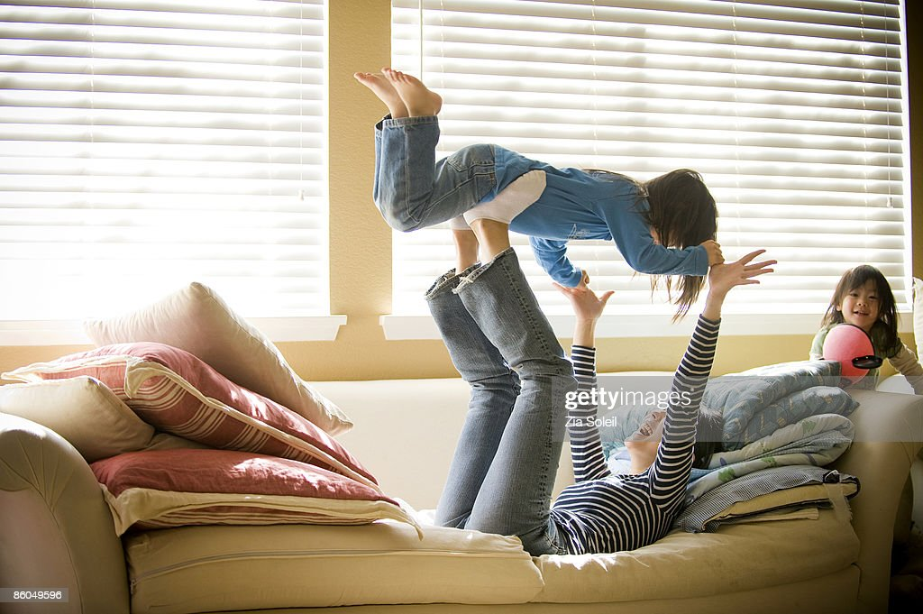 Young Mother & daughters playing at home : Stock Photo