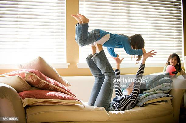 Young Mother & daughters playing at home
