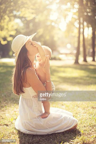 Young mother enjoying in nature with her son