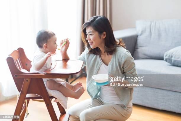 Young mother feeding baby