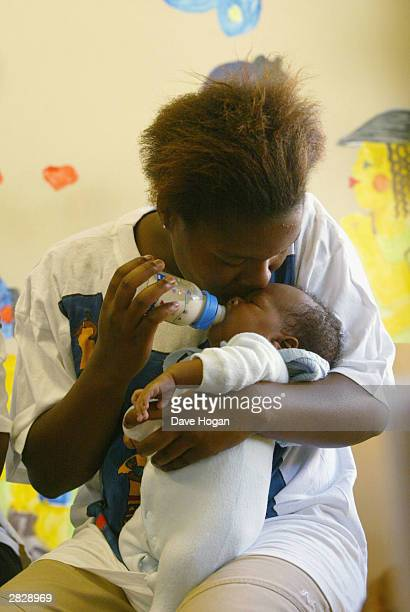 A young mother feeds her baby at the Indawo Yokobelekisa Mothers 2 Mothers centre for young single mothers who have the opportunity to help each...