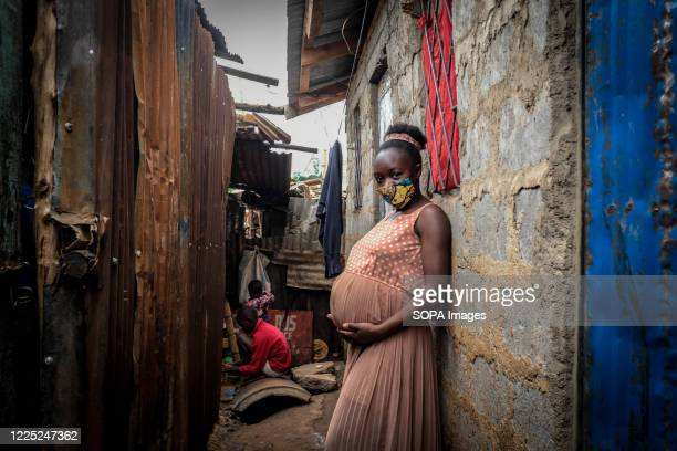 Young mother is seen holding her 8 months baby bump in Kibera Slums Nairobi. Some research indicates that up to a third of more of girls aged between...