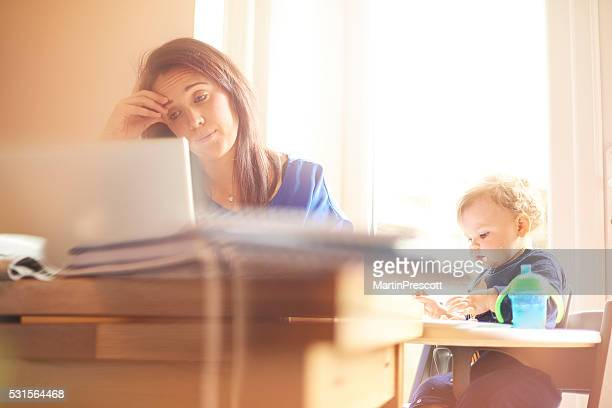 young mother juggling work and child care - struggle stock pictures, royalty-free photos & images