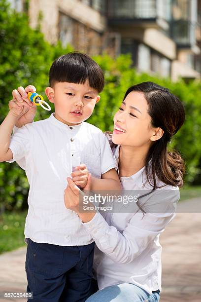 Young Mother Playing Games with Her Son