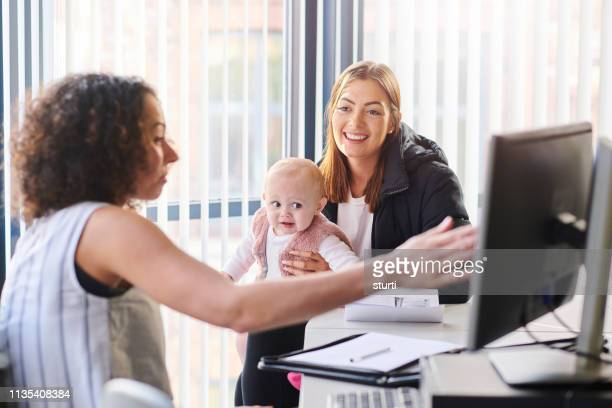 young mother re entering education - social services stock pictures, royalty-free photos & images