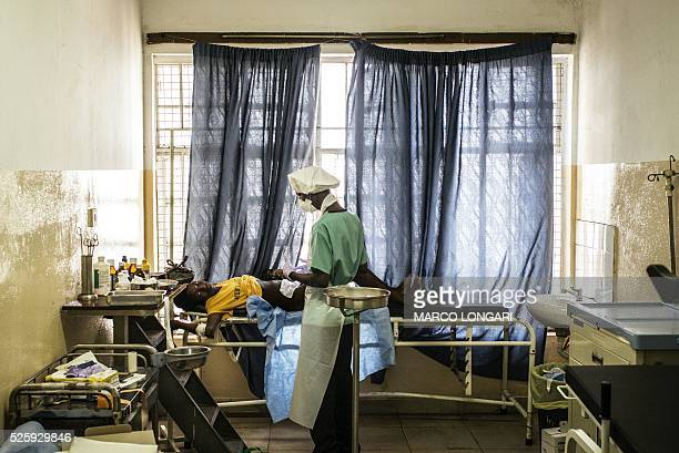 A young mother receives a post cesarian dressing at the Princess Christian Maternity Hospital in Freetown on April 25 2016 With the head nurse of the...