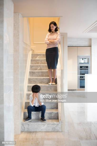 young mother scolding her son at home - 説教 ストックフォトと画像