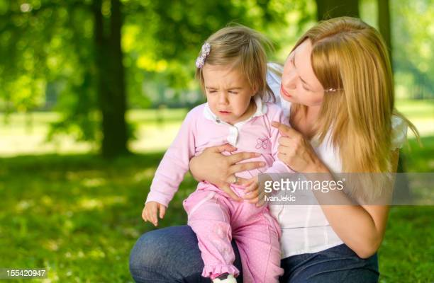 Young mother scolds her daughter