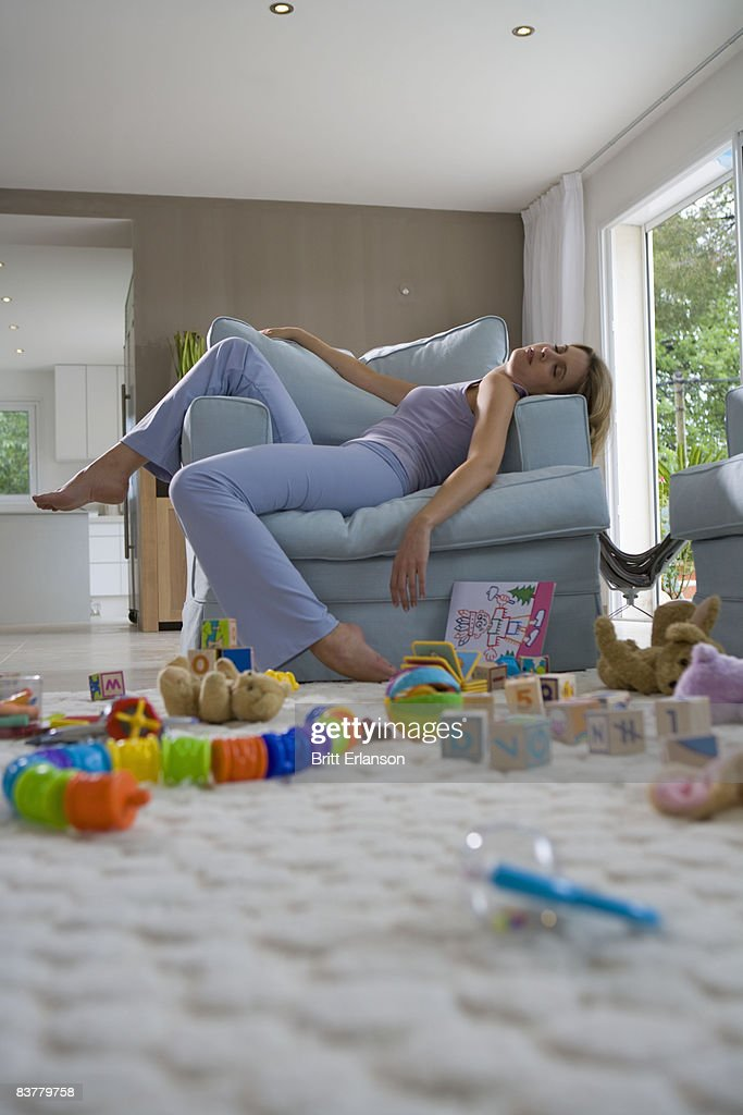 Young mother sleeping on chair : Stock Photo