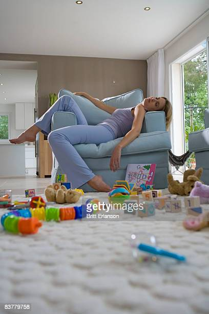 Young mother sleeping on chair