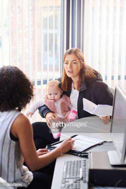 young mother social services - social issues stock pictures, royalty-free photos & images