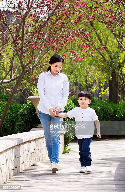 Young Mother Walking with Her Son
