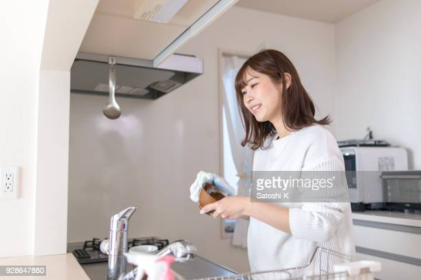 young mother washing dishes - housework stock pictures, royalty-free photos & images