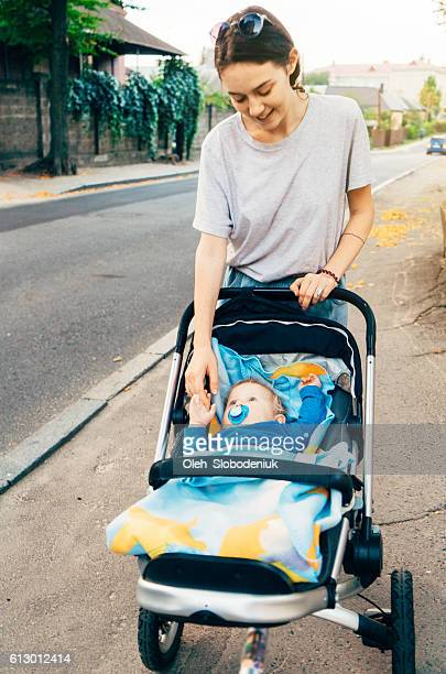 Young mother with child in pram