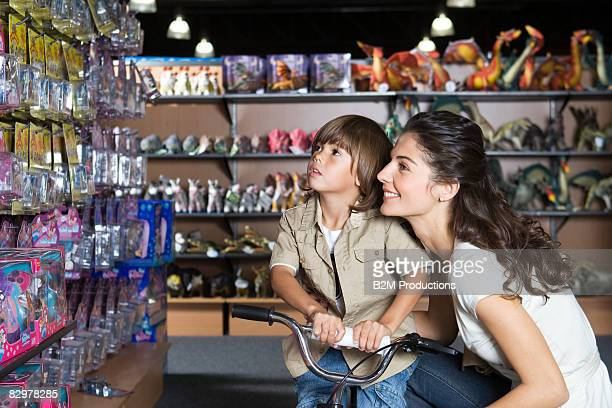 Young mother with child (4-5 years) in toy store