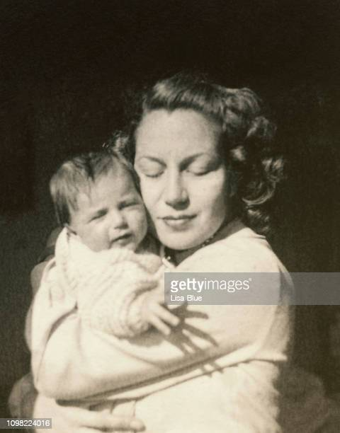 young mother with her baby in 1948 - photography stock pictures, royalty-free photos & images