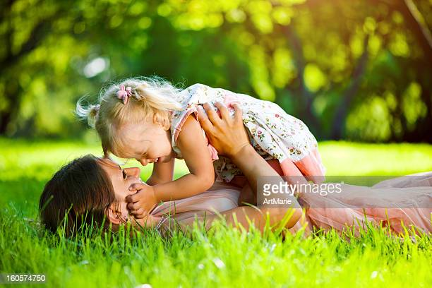 Young mother with her daughter in park