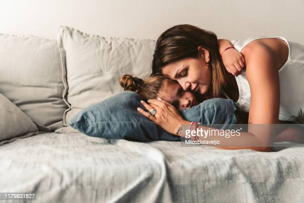 young mother with her daughter - mid adult stock pictures, royalty-free photos & images