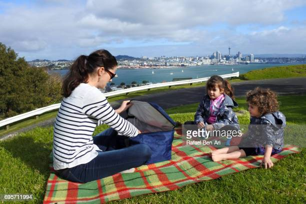 Young mother with two daughters having a picnic