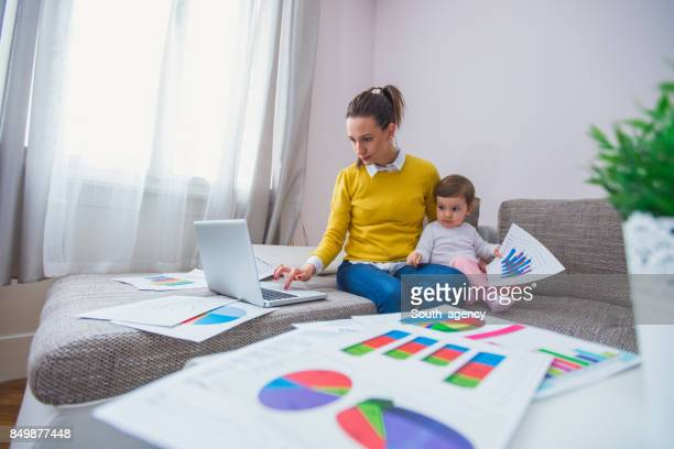 Young mother working at home