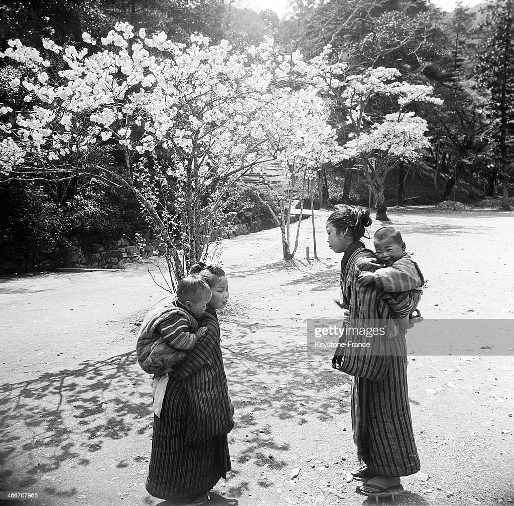 Young Mothers and Cherry Blossoms in a Park of Kyoto, circa 1930.
