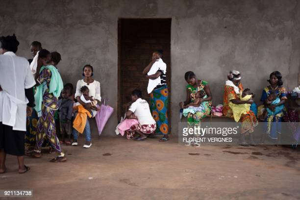 Young mothers wait to weigh their children on February 14 2018 at the maternity in Boali which has no running water and only one doctor In Central...