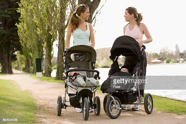 Young Mothers Walking with Their Babies