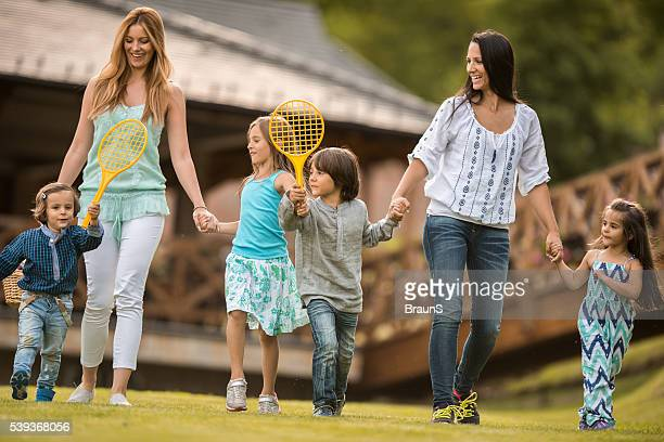 Young mothers walking with their children in the park.