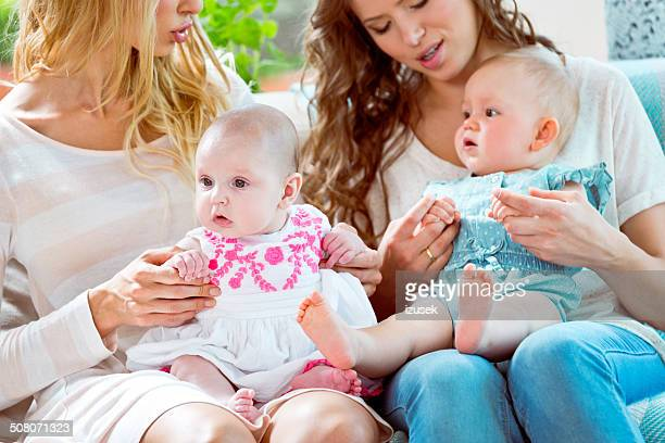 young mothers with babies - izusek stock pictures, royalty-free photos & images
