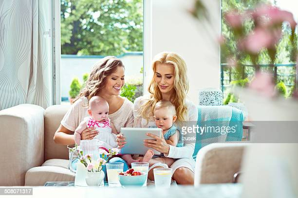 young mothers with their babies - izusek stock pictures, royalty-free photos & images