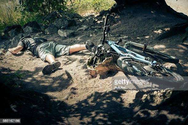 Young mountain biker fallen off his bike