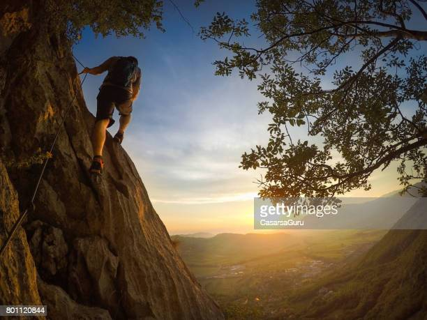 young mountain climber on his way to the top - free climbing stock pictures, royalty-free photos & images