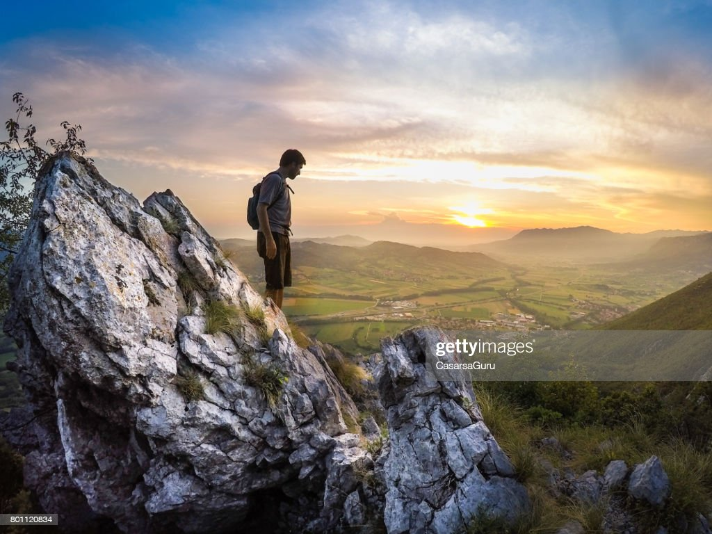 Young Mountain Climber on the Top of Mountain : Stock Photo