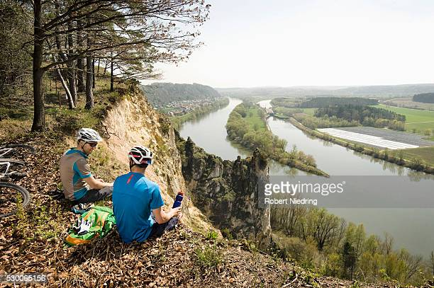 Young mountainbikers taking rest, Bavaria, Germany