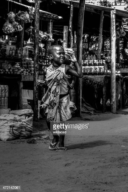 young mozambican child with her baby sister - maputo city stock pictures, royalty-free photos & images