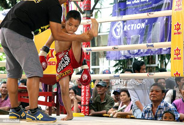 A young Muay Thai boxers warm up before a fight at king Taksin's birthday celebration in Bangkok