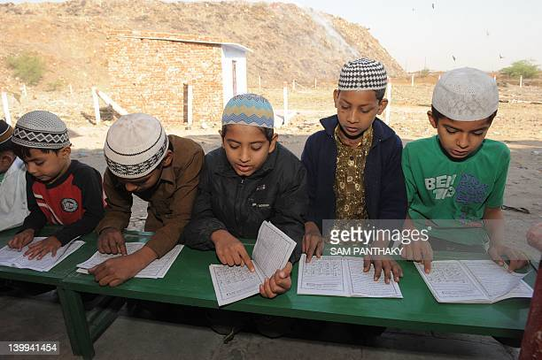 Young Mulim boys attend a lesson at a community Madressa in the refugee settlement 'Citizen Nagar' for Muslims affected by the Gujarat riots near a...