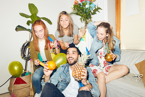 Young multi-ethnic friends enjoying dinner party at home - gettyimageskorea