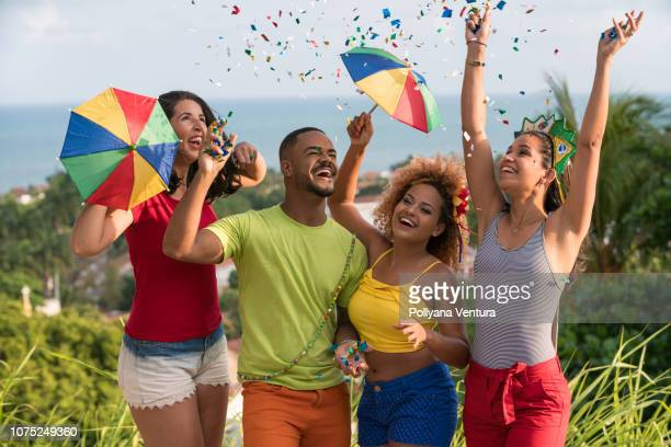 young multi-ethnic hipster people celebrating with confetti - brazilian carnival stock pictures, royalty-free photos & images
