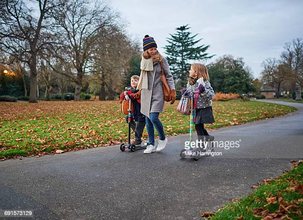 Young mum on school run with her two children