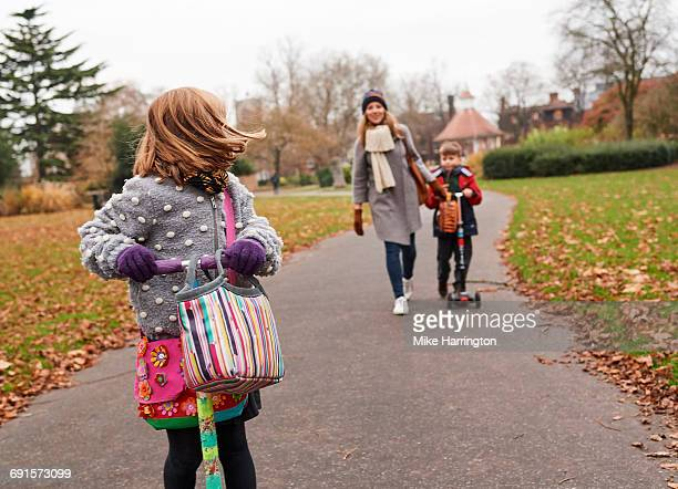 Young mum walking children home from school