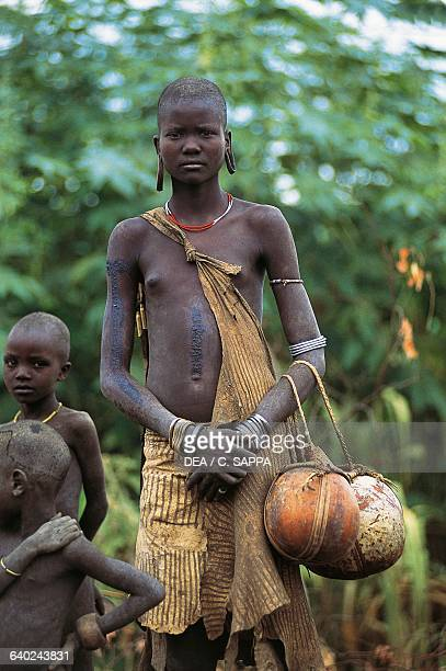 Young Mursi woman and children Mago National Park Ethiopia