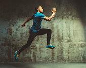 young muscular man doing cross training