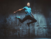 young muscular man jumping