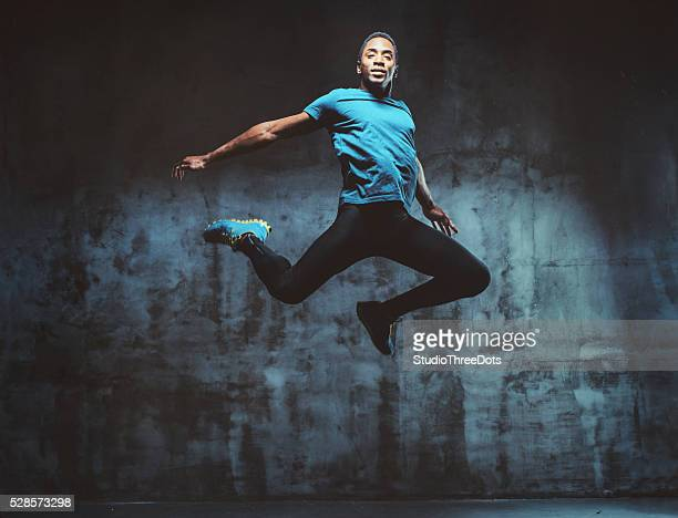 young muscular man jumping