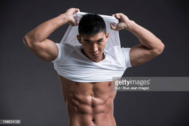 young muscular man - asian six pack stock photos and pictures